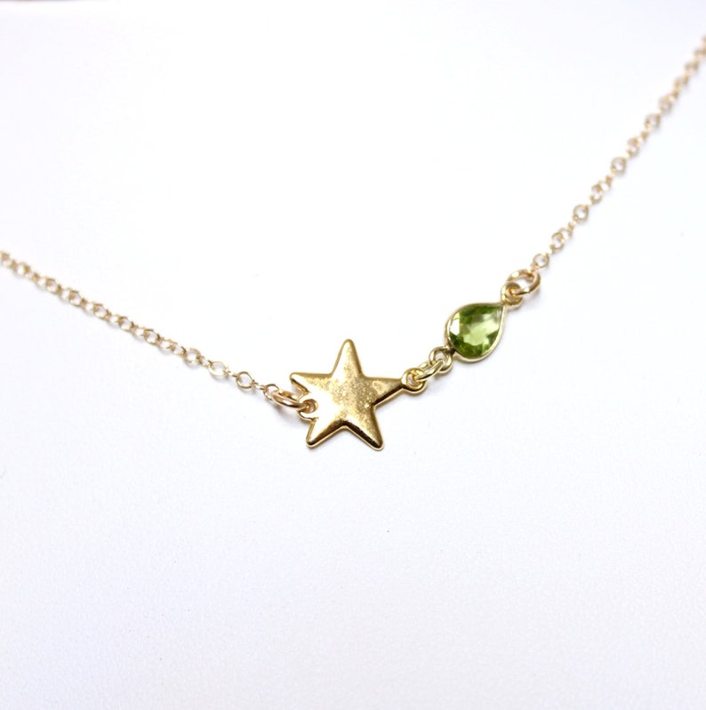 14k gold filled necklace with gold star and peridot in delicate drop shape