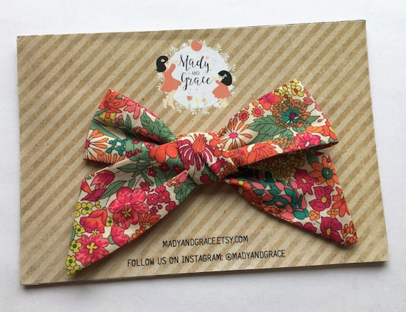 Available w a nylon headband or alligator clip Classic Hand Folded fabric bow in Liberty of London Wildflower floral