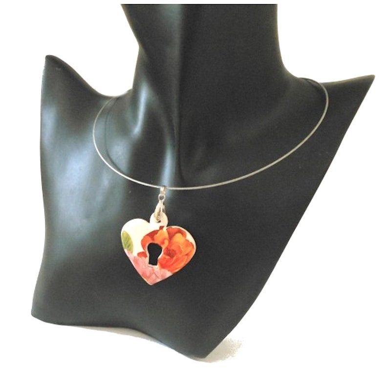 Ceramic pendant heart and key decoration orange pink and green flowers on a white background.