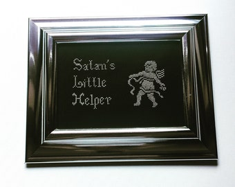 Satan's little helper. Finished and framed cross stitch.