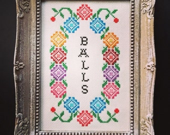 Balls. Finished and framed cross stitch.
