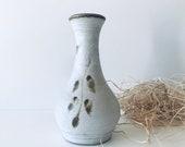 Vintage vase in white sandstone