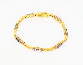 Tanzanite & Diamond 3.14tcw 14kt Yellow Gold Tennis Women's Bracelet