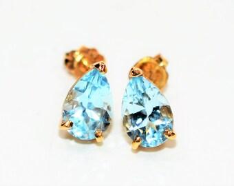 Swiss Blue Topaz 2.90tcw 14kt Yellow Gold Solitaire Stud Women's Earrings