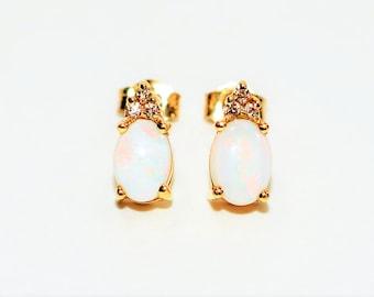 Ethiopian Opal & Diamond 1.09tcw 14kt Yellow Gold Stud Women's Earrings