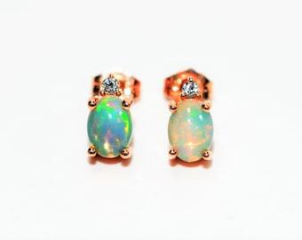 Ethiopian Opal & Diamond 1.26tcw 10kt Rose Gold Stud Women's Earrings
