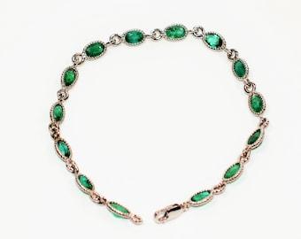 Colombian Emerald 10.50tcw 14kt White Gold Tennis Women's Bracelet