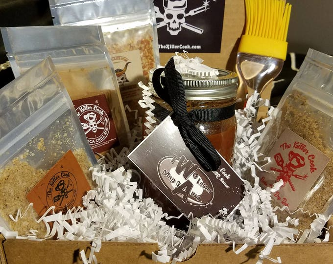Featured listing image: The Killer Cook's Passport to Flavor Gift set with 4 3oz dry rubs, 1 16oz jar of hand crafted Soda Shop BBQ sauce, 1 brush & 1 sticker.