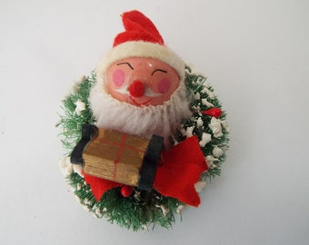 1950s bottle brush flocked wreath with  Santa head ornament Kitsch