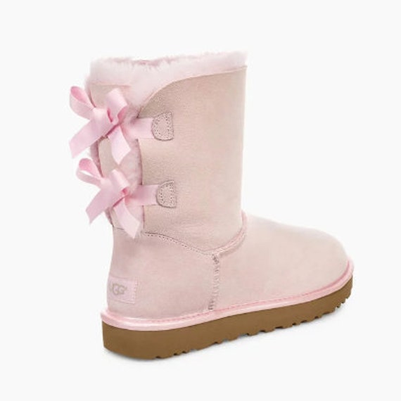 Pink ugg boots with tie on the back and rhinestones! In