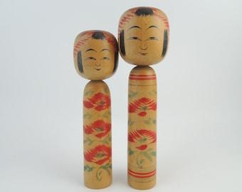Vintage Japanese Kokeshi Dolls, by Bunkichi Sato (1922-2008), set of 2