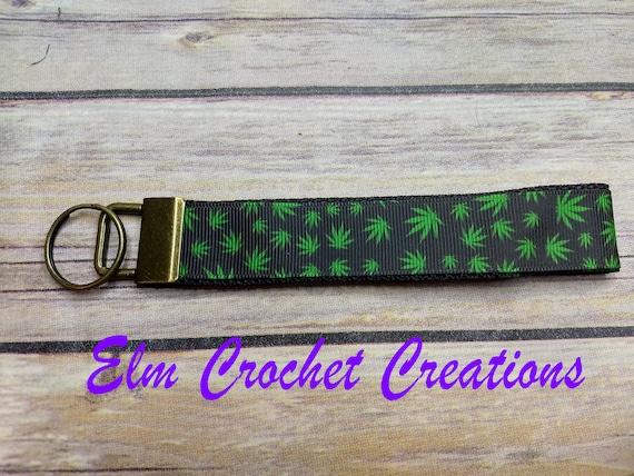 Marijuana key chain with wrist holder