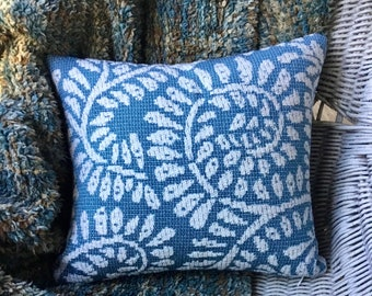 Dark teal blue and white textured pillow cover with coordinating teal blue linen back