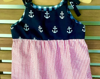 Toddler romper with snap crotch for easy diaper change. Red, white, blue.