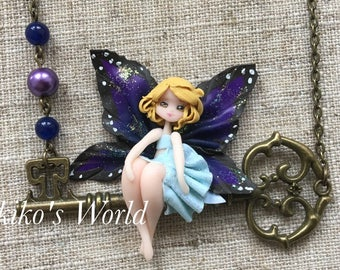 Butterfly fairy necklace - Blonde haired chibi and her blue and purple wings on a bronze key, Kawaii / fantasy jewelry, Polymer clay pendant