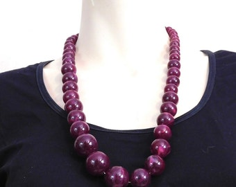 Swirly purple plastic bead necklace with matching clasp