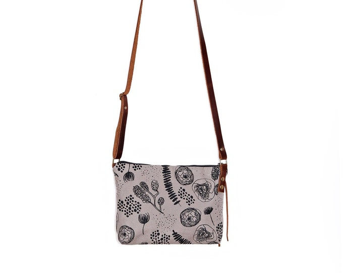 Mini Waxed Canvas Crossbody Bag with Built-In Wallet and Adjustable Leather Strap  - Grey Canvas with Flora and Fauna Pattern