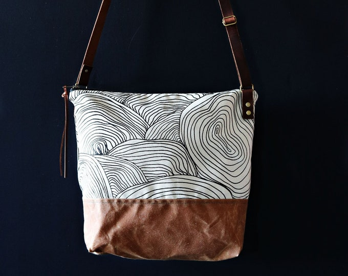 Waxed Canvas Crossbody Bag - Abstract Circle Pattern on Clay Canvas with Whiskey Waxed Canvas and Adjustable Leather Strap