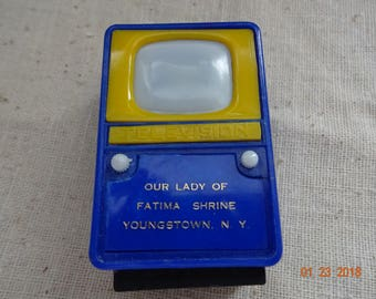 """Little plastic souvenir """"viewmaster"""" television set from Our Lade of Fatima Shrine"""