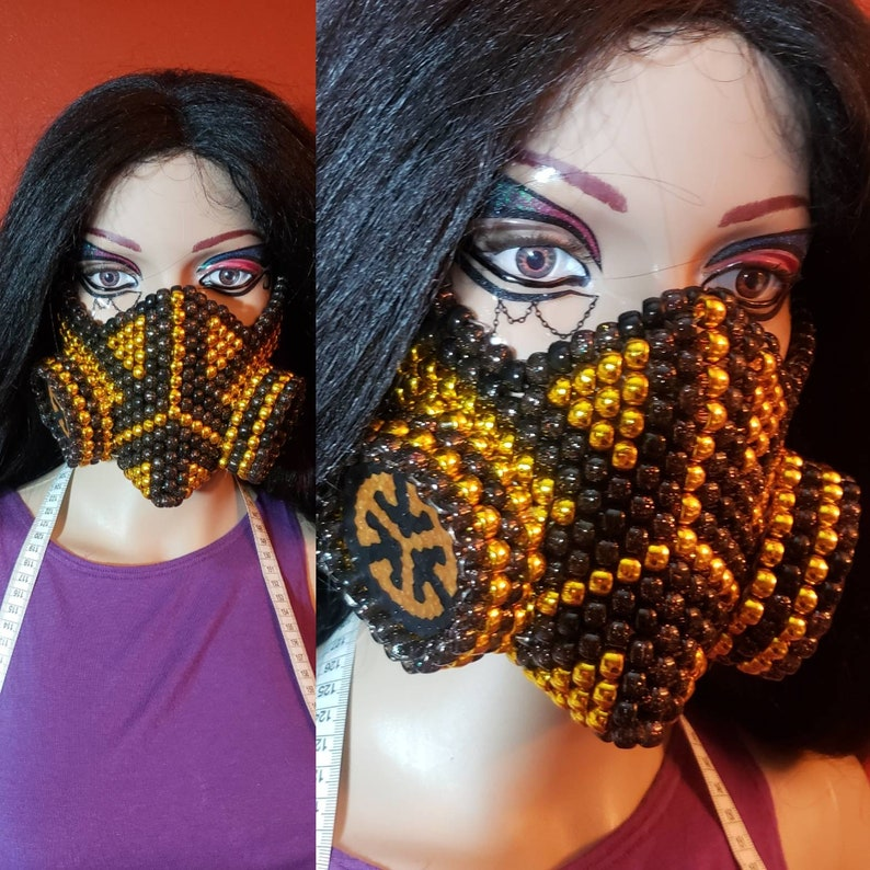 gold /& black Basscon gas mask turn up on bass edc