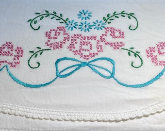 Vintage pillowcase with embroidery and aqua and pink flowers with  and white crochet trim