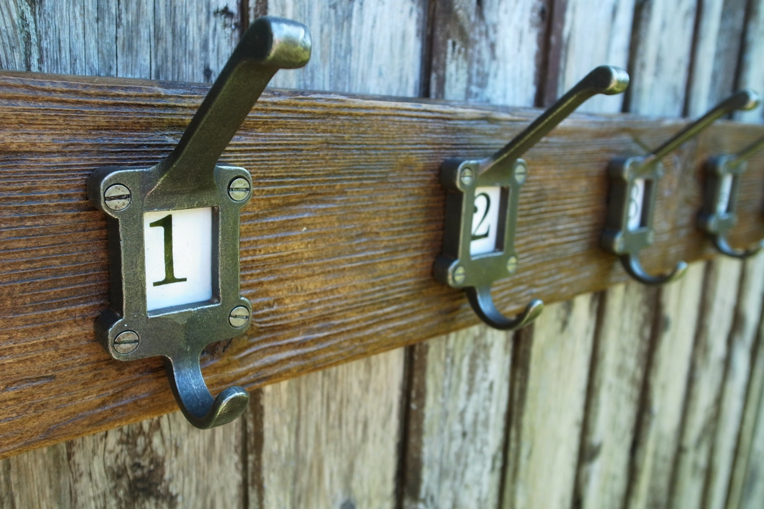 8 X CAST IRON SCHOOL COAT HOOKS WITH CERAMIC NUMBER INSERTS