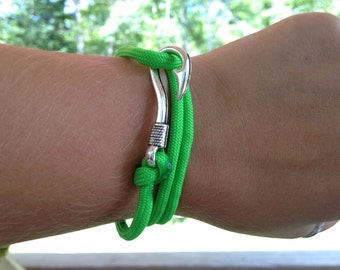 Lime green paracord bracelet with fish hook latch, adjustable