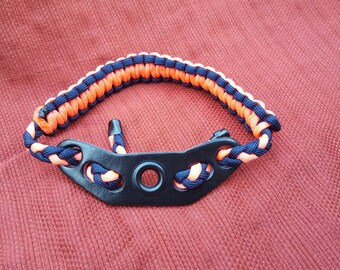 Peach and navy paracor wrist sling.