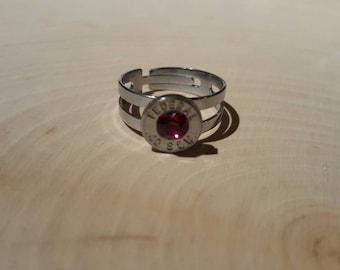 40 caliber, red swarovski crystal, stainless steel adjustable ring