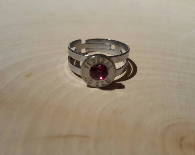 40 caliber, red swarovski crystal, stainless steel adjustable ring