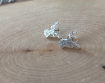 White glittery deer studs, stainless steel posts