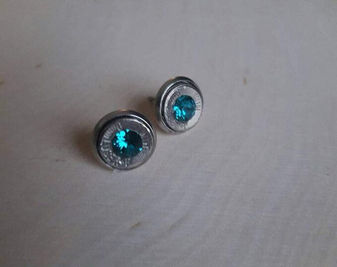 Teal 9mm bullet earrings, backings are stainless steel. Swarovski crystals