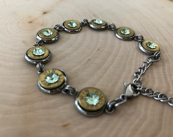 Pale green bracelet, 9mm bullet ends with pale green Swarovski crystals in center.
