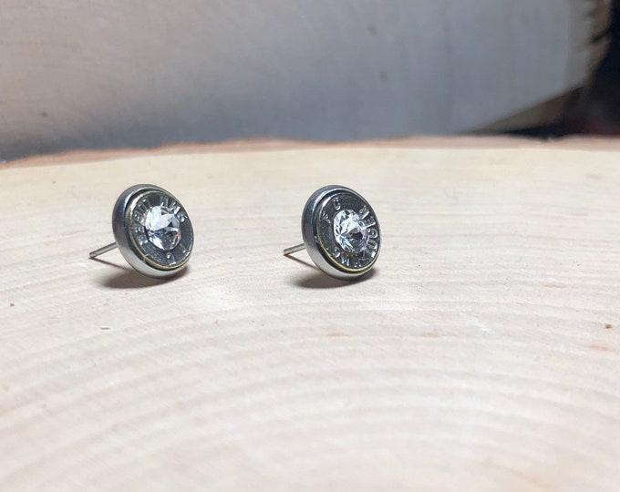 9mm clear studs, stainless steel backing
