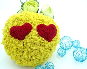 Small yellow pillow with heart eyes