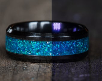Glowing Blue Opal Black Ceramic Ring