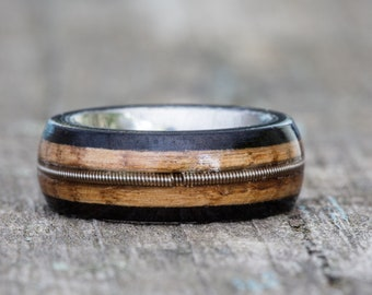 Tennessee Whiskey Barrel, Ebony, and Titanium Ring with Guitar String Inlay