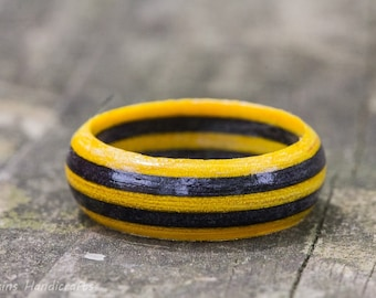 Yellow and Gray Wood Ring