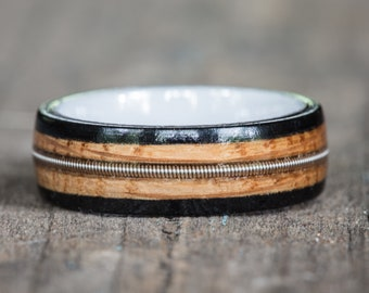 Tennessee Whiskey Barrel, Ebony, and White Ceramic Ring with Guitar String Inlay