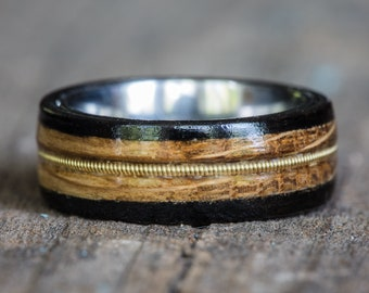 Tennessee Whiskey Barrel, Ebony, and Titanium Ring with Brass Guitar String Inlay