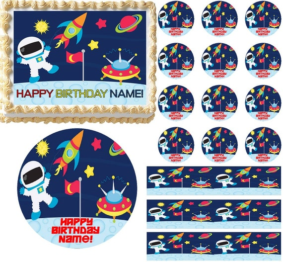 Outer space themed birthday party plates, cake frosting sheet and party supplies
