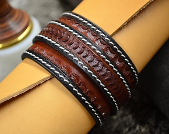 Engraved leather strap.