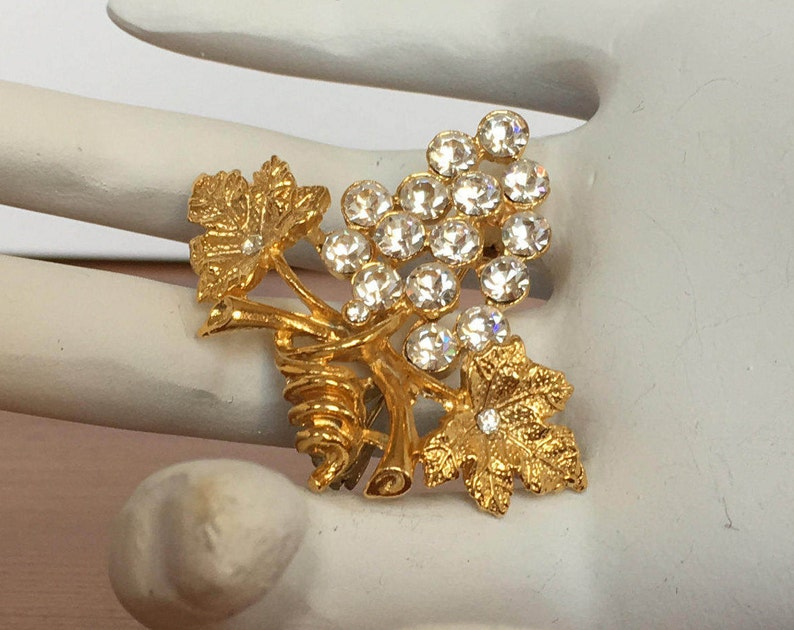 Grape and leaf cluster brooch vintage gold tone pin clear rhinestones