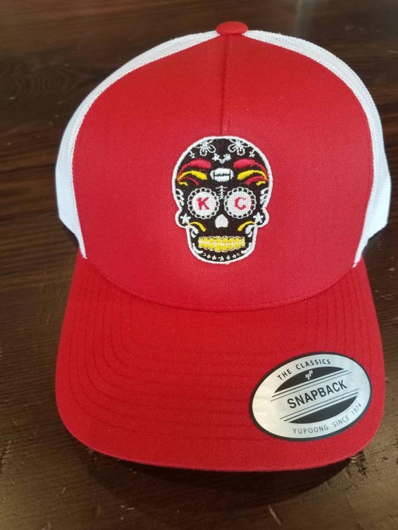 173b62db KC Chiefs sugar skull trucker hat