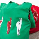 bio cotton tote bag with screenprint of 3 guanaco's (type of llama), red or green tote bag, shopper, market bag