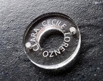 Round plexiglass piece engraved for jewelry design