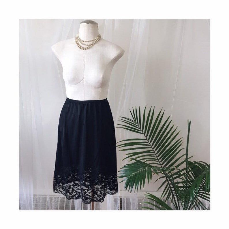 vintage inky black satin skirt slip sheer floral lace trim 1960s 1970s SONE retro pin-up half-slip lingerie