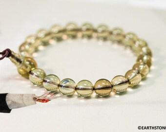 Burmese Jadeite 10 mm 0.40 inch beads stretchy bracelet 7.5 inches long