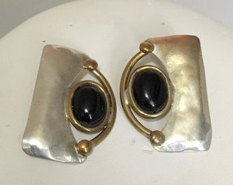 Sterling silver stud earrings with brass wire accents and black onyx stones