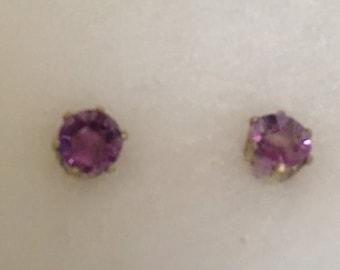 Circle amethyst stud earrings with sterling silver bezel